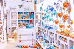 Vintage souvenir shop with traditional Greek ceramics in Oia town on Santorini island, Greece.