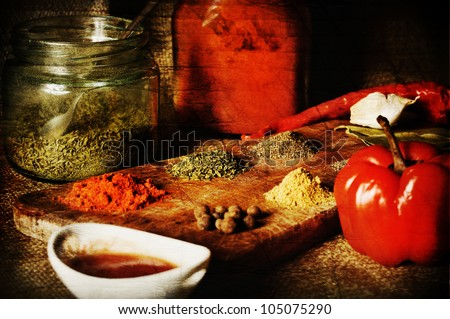 vintage spice composition in wood textured background - stock photo