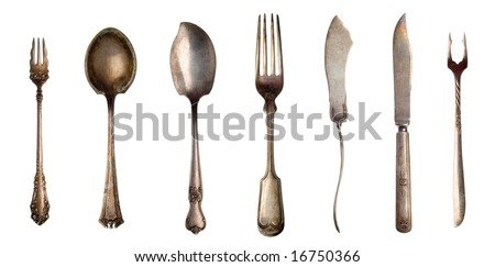 Vintage spoons, forks and knifes isolated on white