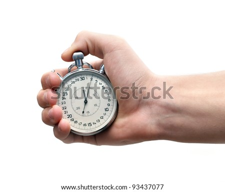 Vintage sport timer stop watch in a man's hand. Isolated on white