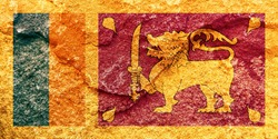 Vintage Sri Lanka national flag icon pattern isolated on weathered solid rock wall background, abstract positive design faithful Ceylon politics society conflicts issues concept texture wallpaper
