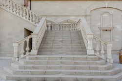 Vintage stairs from white marble in an old antique building