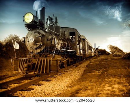 Vintage Steam engine locomotive train moving down railroad track towards camera. American flags on front, Hand painted black and white photograph. - stock photo