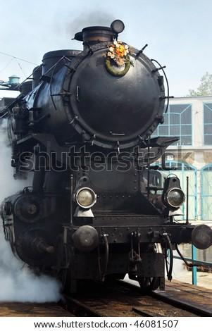 Vintage steam engine on work on the turntable