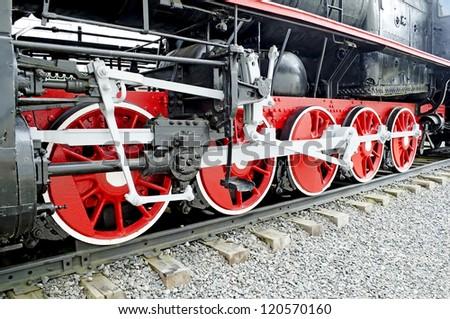 Vintage steam locomotive. The steam locomotive wheels close-up