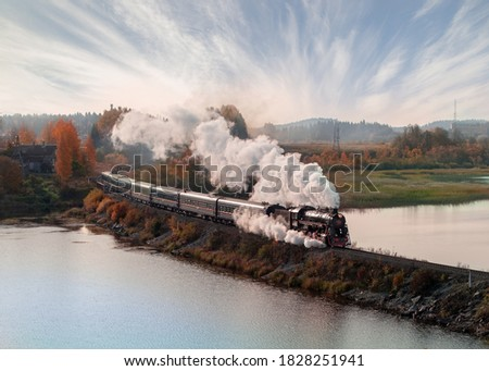 Vintage steam locomotive train in the autumn landscape. Photo stock ©