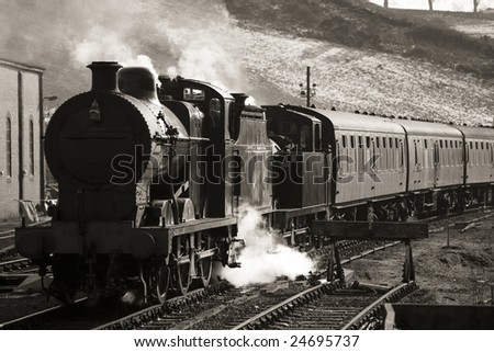 vintage steam train photographed in black and white with identification markings removed