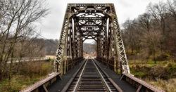 vintage steel railroad bridge in the country