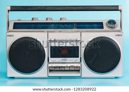 Vintage stereo on blue pasrel color background