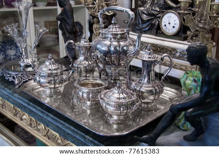 Vintage sterling silver Coffee Tea set displayed in antique store Stock photo ©