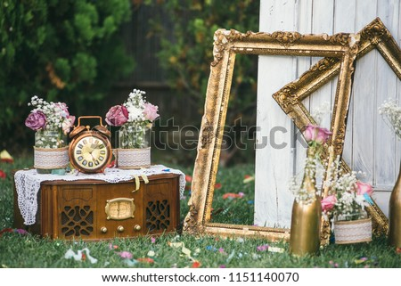 Vintage still life decoration for wedding reception. Marriage and love concept in retro style. Bridal arrangement.