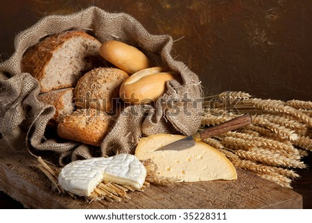 Vintage still life of bread rolls and French cheese