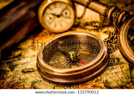 Vintage still life Vintage compass lies on an ancient world map