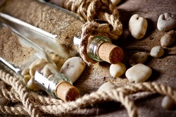 Vintage still life with bottle and seashell