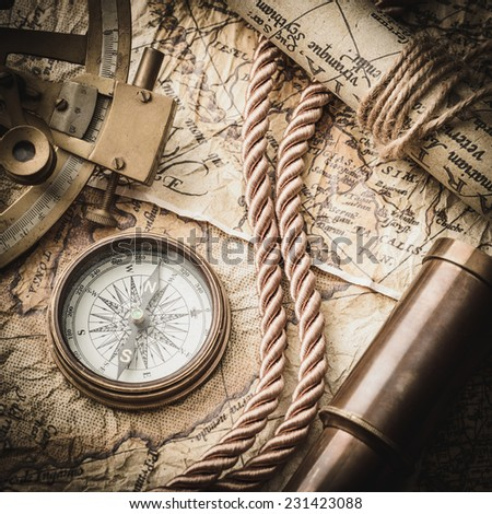 vintage  still life with compass,sextant and old map. map of the 1570. Author: Abraham Ortelius (1527-1598)  #231423088