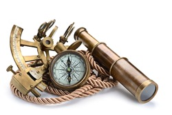 vintage still life with compass,sextant and spyglass isolated on white background
