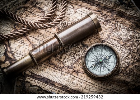 vintage  still life with compass ,sextant ,spyglass ,and old map #219259432
