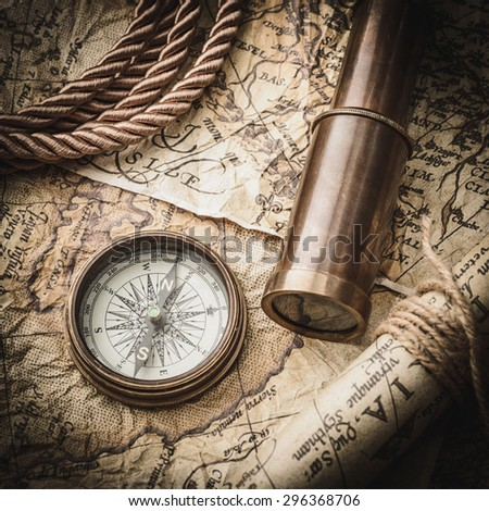 vintage still life with compass,spyglass and old map #296368706