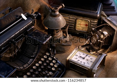 Vintage still life with old camera,radio and typewriter