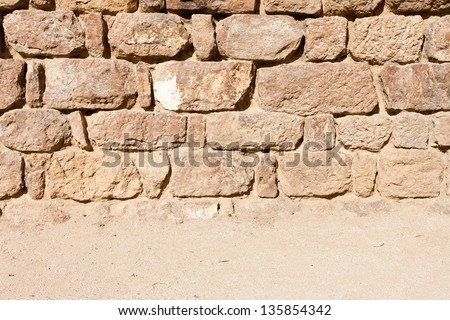 Vintage stone wall and sandy floor texture background