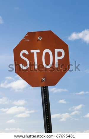 VINTAGE Stop sign against vast blue sky