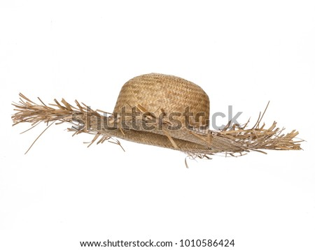 Vintage straw beach hat hat, isolated on white background.  Side view. Tilted up a little, showing the interior. #1010586424