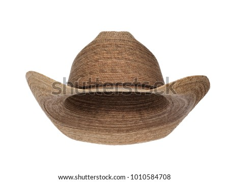 Vintage straw latin american cowboy hat isolated on white background.  Straight front view. Tilted up a little, showing the interior.