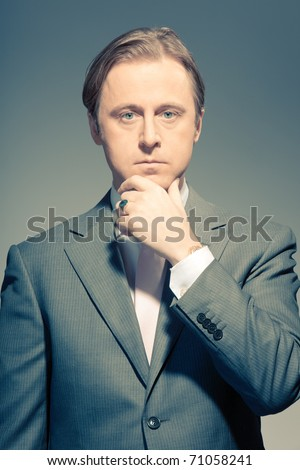 Vintage studio portrait of a serious young business man. Thinking. In thought. In mind. Concentration. Boss. Power. Old photo. - stock photo