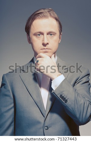 Vintage studio portrait of serious young business man. Power. Boss. Proud. Concentration. Ambition.