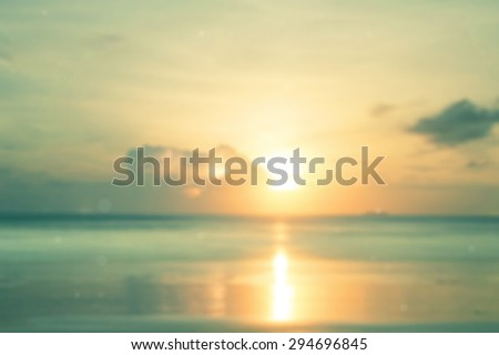 Vintage style. Abstract blurred textured background: orange and green patterns. Blurred nature background. Moon in clouds over yellow sea sunset blurred background.