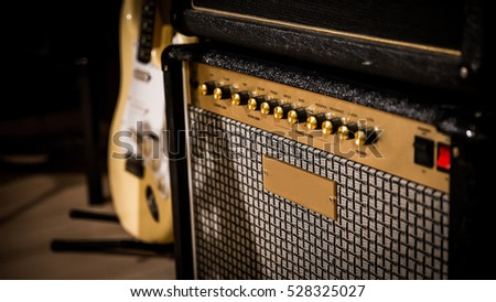 Stock Photo vintage style amp and guitar in the background.