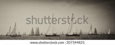 Vintage style black and white image of a sailing regatta on the sea