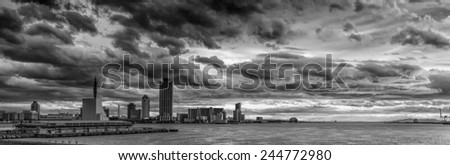 Vintage style black and white image of the stormy sky above the Port of Osaka in Japan. The Port of Osaka is the main port in Japan, located in Osaka within Osaka Bay.