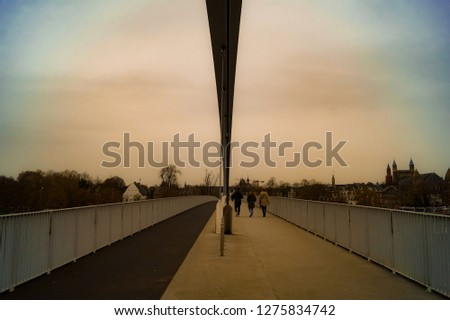 Vintage style bridge old one point perspective with walking people and symmetry