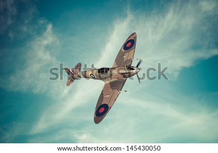 Vintage style colored artwork of a Battle of Britain era British RAF Spitfire fighter at high altitude This aircraft became famous during the summer of 1940 Artist's impression