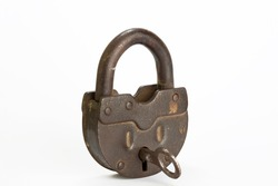 Vintage style copper lock and key isolated on white background. Antique objects. Horizontal close-up.