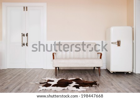 vintage style cozy room with old refrigerator, bench, carpet and door