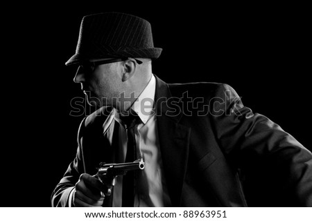 Vintage style Detective posing with Handgun