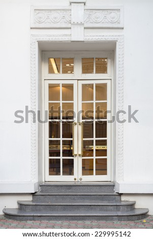 Vintage style doors in front of building