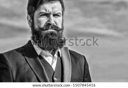 Vintage style long beard. Facial hair beard and mustache care. Beard fashion trend. Invest in stylish appearance. Man bearded hipster wear formal suit blue sky background. Epic beard growing guide.