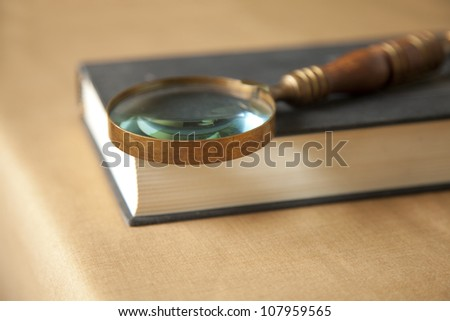 Vintage style magnifying glass on a book