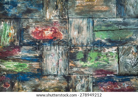 Vintage style, painted in various colors, old damaged teakwood table board with rough surface of wood texture, cracks, grain. Natural material backgrounds and teak furniture manufacturing in Indonesia