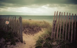 Vintage style photo of beach entrance on Cape Cod with a