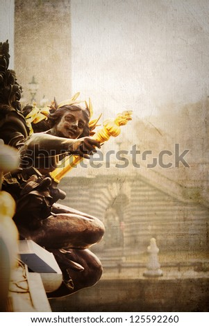 vintage style picture of an angel sculpture at the bridge Pont Alexandre in Paris with space to copy - stock photo