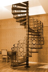 Vintage style picture of an old spiral stairs
