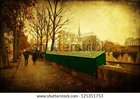 vintage style picture of Paris with closed stalls along the river Seine and the famous church Notre Dame in the background