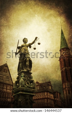 vintage style picture of the famous Justitia statue in Frankfurt, Germany