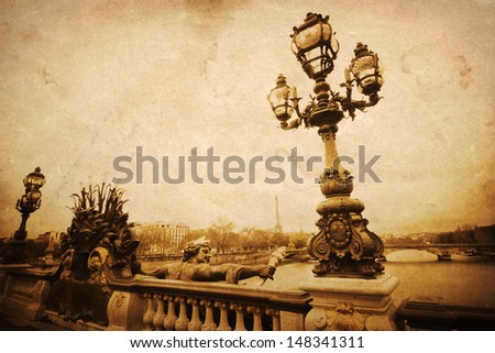 vintage style picture of the historical Seine bridge Pont Alexandre III with the Eiffel Tower far in the background