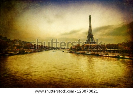 vintage style picture of the river Seine in Paris with Eiffel Tower