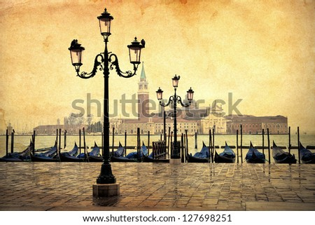 vintage style picture of Venice with gondolas and old street lamps - stock photo